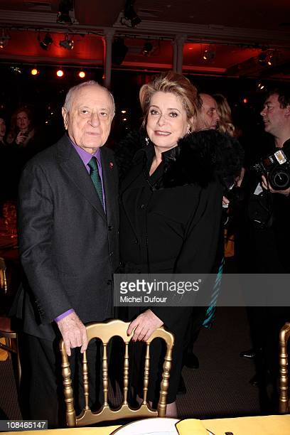 Pierre Berge and Catherine Deneuve attend the Sidaction Gala Dinner 2011 at Pavillon d'Armenonville on January 27 2011 in Paris France