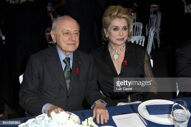 Pierre Berge and Catherine Deneuve attend the the Sidaction Gala Dinner 2012 on January 26 2012 in Paris France