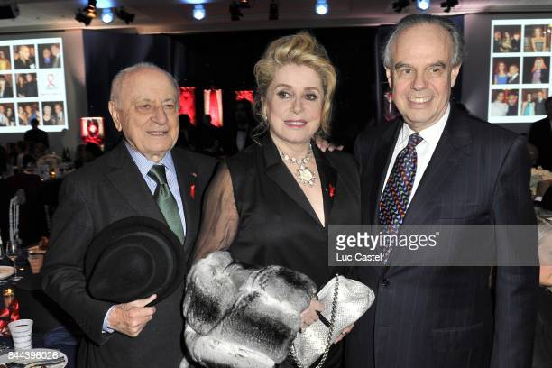 Pierre Berge Catherine Deneuve and Frederic Mitterrand attend the the Sidaction Gala Dinner 2012 on January 26 2012 in Paris France