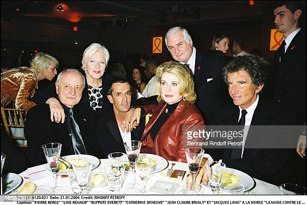Pierre Berge Line Renaud Ruppert Everett Catherine Deneuve Jean Claude Brialy and Jacques Lang at the Fashion Against AIDS party