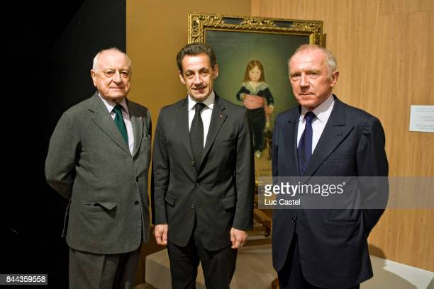 Pierre Berge Nicolas Sarkozy and Francois Pinault attend the 'Pierre Berge' event at Grand Palais on February 20 2009 in Paris France
