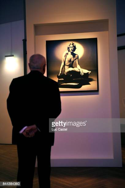 Pierre Berge watches Yves SaintLaurent on an Artwork at Petit Palais on March 09 2010 in Paris France