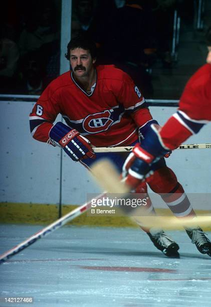 Pierre Bouchard of the Montreal Canadiens skates on the ice during warm ups before an NHL game circa 1973