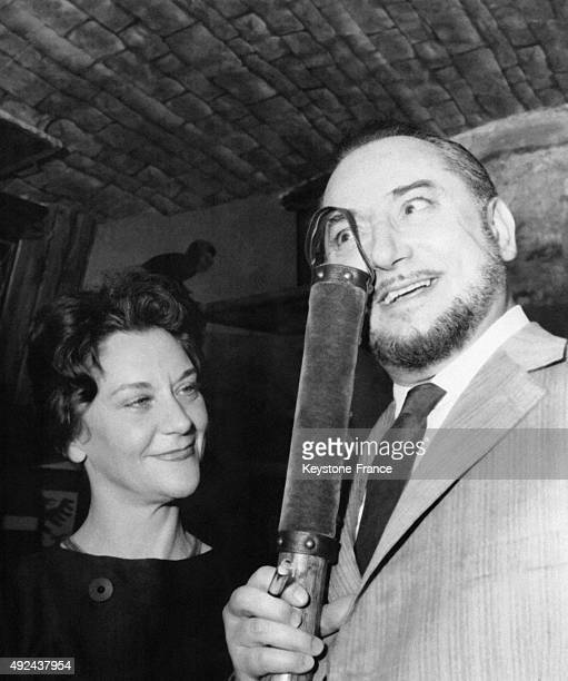 Pierre Brasseur holding the 'Prix du Brigadier' which awards the theatrical event of the year and Maria Casares after the declaration of the result...