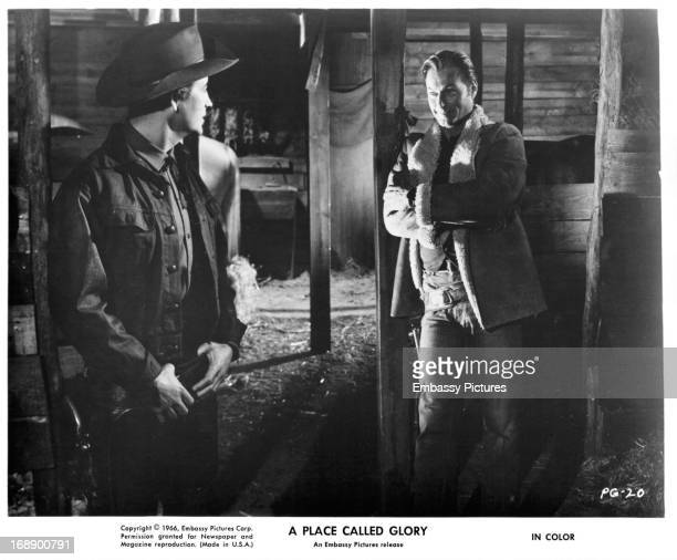 Pierre Brice and Lex Barker meet up in a barn in a scene from the film 'A Place Called Glory' 1965