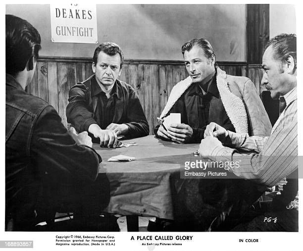 Pierre Brice Lex Barker and others play cards in a scene from the film 'A Place Called Glory' 1965