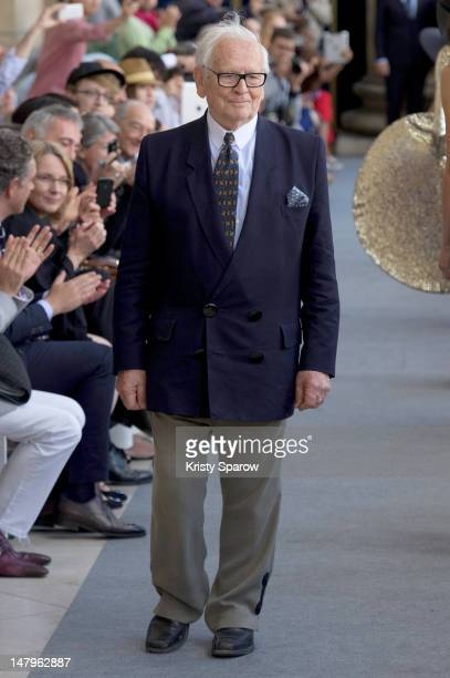 Pierre Cardin acknowledges the crowd during the Pierre Cardin Menswear Spring / Summer 2013 show as part of Paris Fashion Week at Palais Brongniart...