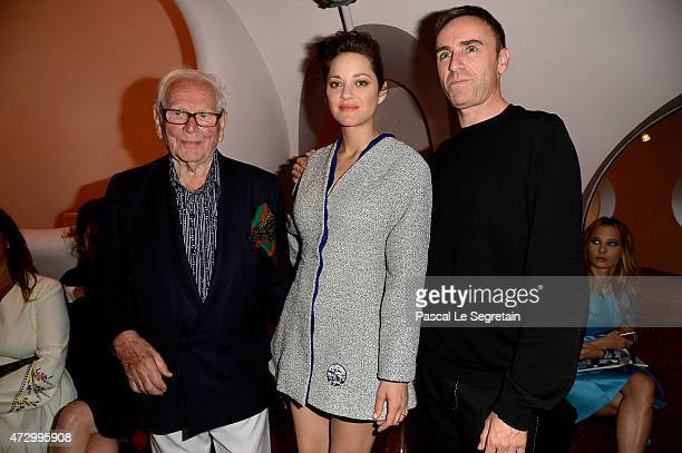 Pierre Cardin Marion Cotillard and Raf Simmons attend the Dior Croisiere 2016 at Palais Bulle on May 11 2015 in Theoule sur Mer France