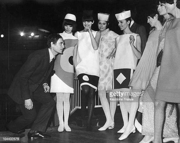 Pierre CARDIN showing his models how to curtsey These models wearing clothing created by P CARDIN will be curtseying in front of Princess Margaret...