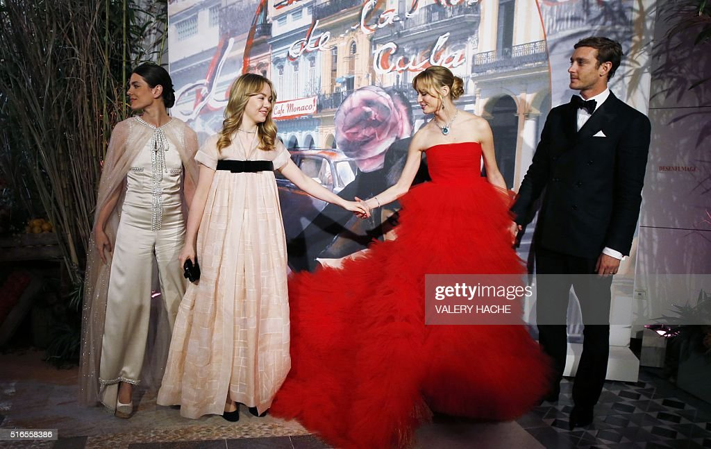 Pierre Casiraghi (R), Beatrice Borromeo - Casiraghi (2ndR), Princess Alexandra of Hanover (2ndL) and Charlotte Casiraghi (L) arrive for the annual Rose Ball at the Monte-Carlo Sporting Club in Monaco, on March 19, 2016. The Rose Ball is one of the major charity events in Monaco. Created in 1954, it benefits the Princess Grace Foundation. / AFP / VALERY