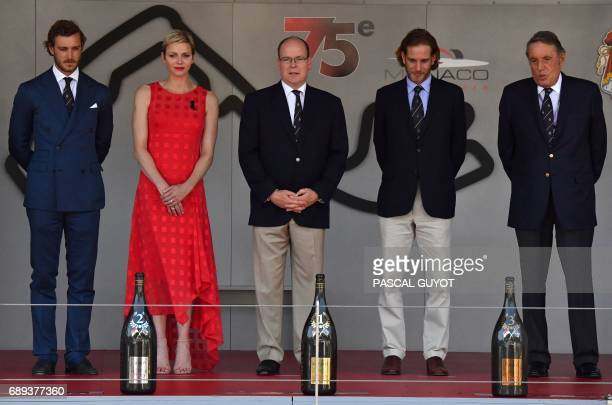 Pierre Casiraghi son of Princess of Hanover Princess Charlene of Monace Prince Albert II of Monaco Andrea Casiraghi and an identified person stand on...