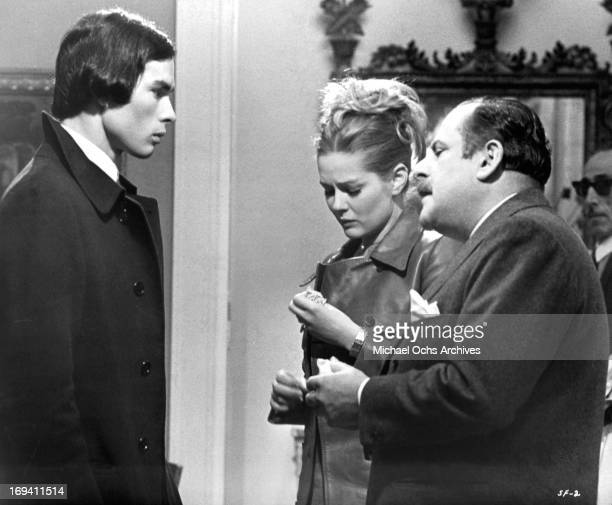 Pierre Clementi is bid a tearful goodbye by Beba Loncar with Carlo Caprioli at her side in a scene from the film 'Listen Let's Make Love' 1968