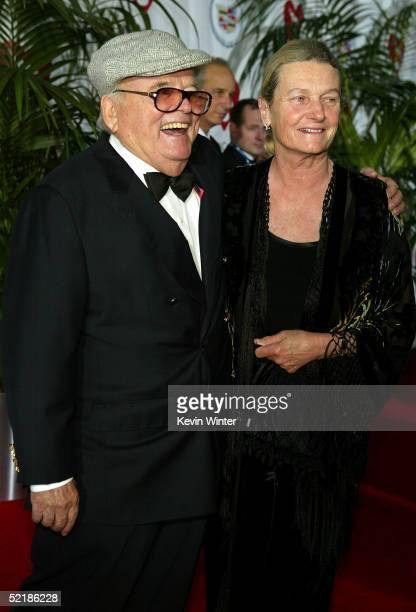 Pierre Cosset and wife Mary arrive at the MusiCares 2005 Person of the Year Tribute to Brian Wilson at the Palladium on February 11 2005 in Hollywood...