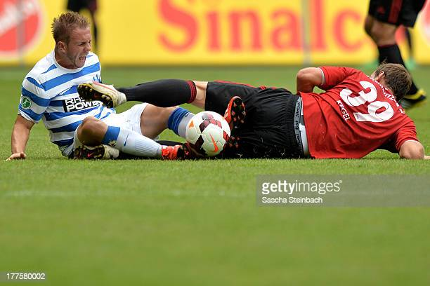 Pierre De Wit of Duisburg is tackled by Maik Kegel of Chemnitz during the 3 Liga match between MSV Duisburg and Chemintzer FC at...