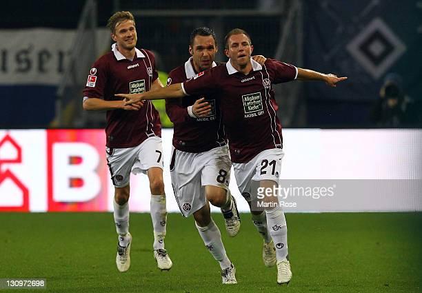 Pierre de Wit of Kaiserslautern celebrates after scoring the opening goal during the Bundesliga match between Hamburger SV and 1. FC Kaiserslautern...