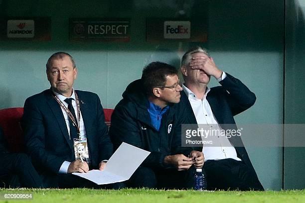 Pierre Denier assistant coach of KRC Genk Rudi Cossey assistant coach of KRC Genk and Peter Maes head coach of KRC Genk look dejected pictured during...
