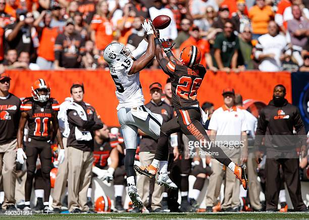 Pierre Desir of the Cleveland Browns breaks up a pass intended for Michael Crabtree of the Oakland Raiders during the first quarter at FirstEnergy...