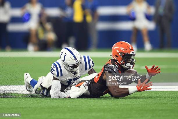 Pierre Desir of the Indianapolis Colts defends a pass intended for DJ Montgomery of the Cleveland Browns during the first half of a preseason game at...