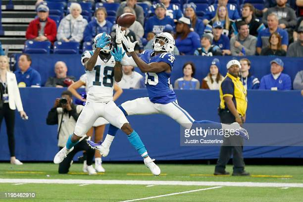 Pierre Desir of the Indianapolis Colts intercepts the ball in the game against the Carolina Panthers during the fourth quarter at Lucas Oil Stadium...