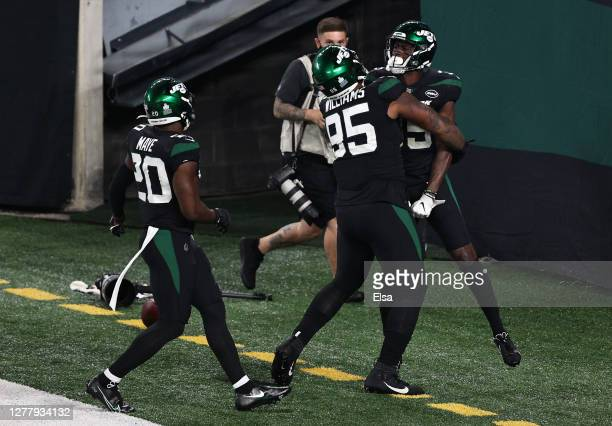 Pierre Desir of the New York Jets celebrates a pick six with teammates against the Denver Broncos during the fourth quarter at MetLife Stadium on...