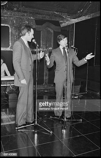 Pierre Douglas and Thierry Le Luron on stage during a party at Elysee Matignon night club in Paris in 1977