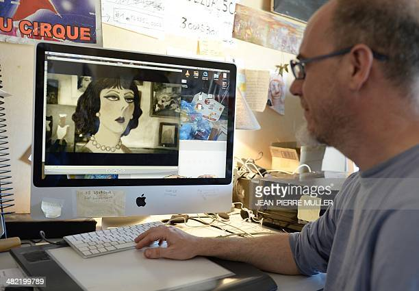 Pierre Elissalde founder and producer of the animation studio 'Les Trois Ours' watches in Angouleme central France on March 17 a scene from the...