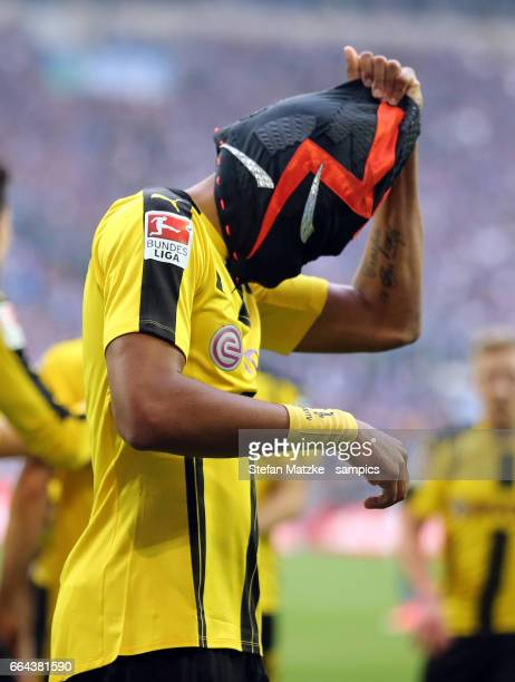 Pierre Emerick Aubameyang celebrates as he scores the goal with a mask during the Bundesliga match between FC Schalke 04 and Borussia Dortmund at...