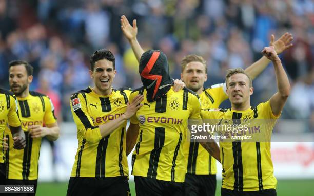 Pierre Emerick Aubameyang celebrates as he scores the goal with a mask with Marc Barta Borussia Dortmund Felix Passlack Borussia Dortmund Julian...