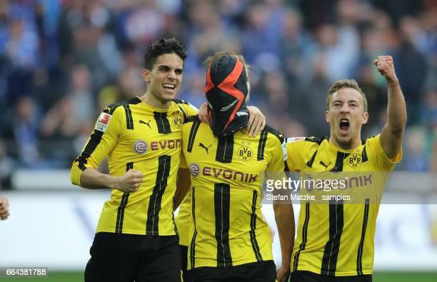 Pierre Emerick Aubameyang celebrates as he scores the goal with a mask with Marc Barta Borussia Dortmund Felix Passlack Borussia Dortmund during the...