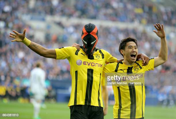 Pierre Emerick Aubameyang celebrates as he scores the goal with a mask with Shinji Kagawa during the Bundesliga match between FC Schalke 04 and...