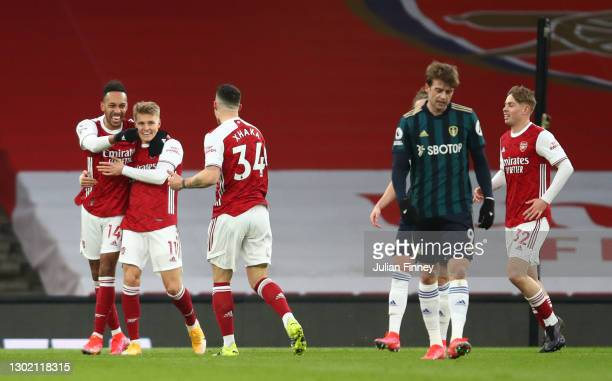 Pierre Emerick Aubameyang of Arsenal celebrates with team mates Martin Odegaard and Granit Xhaka after scoring their side's first goal during the...