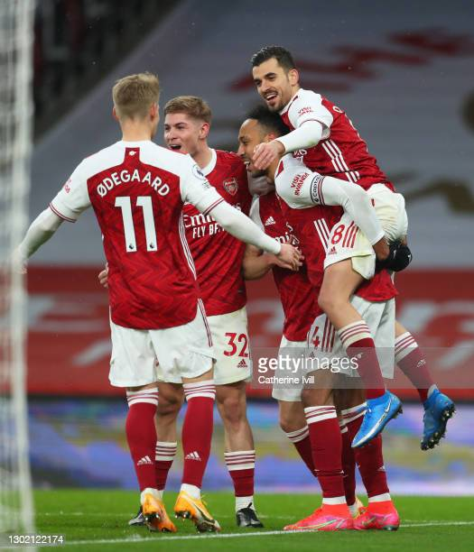 Pierre Emerick Aubameyang of Arsenal celebrates with team mates Martin Odegaard, Emile Smith Rowe and Dani Ceballos after scoring their side's second...