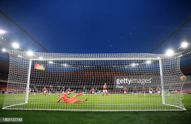Pierre Emerick Aubameyang of Arsenal scores their side's second goal past Illan Meslier of Leeds United from the penalty spot during the Premier...