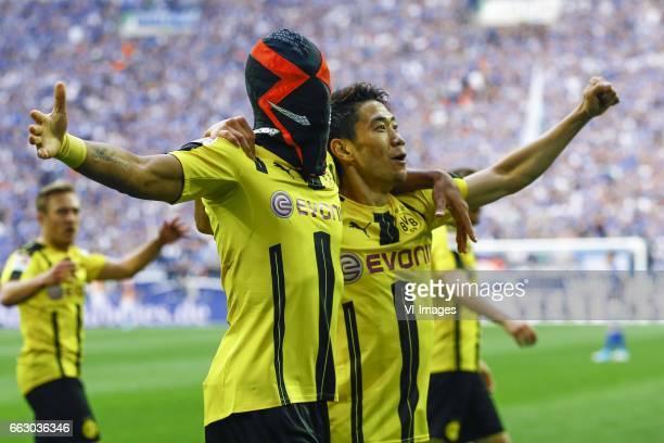 Pierre Emerick Aubameyang of Borussia Dortmund scored and wears a mask Shinji Kagawa of Borussia Dortmundduring the Bundesliga match between Schalke...