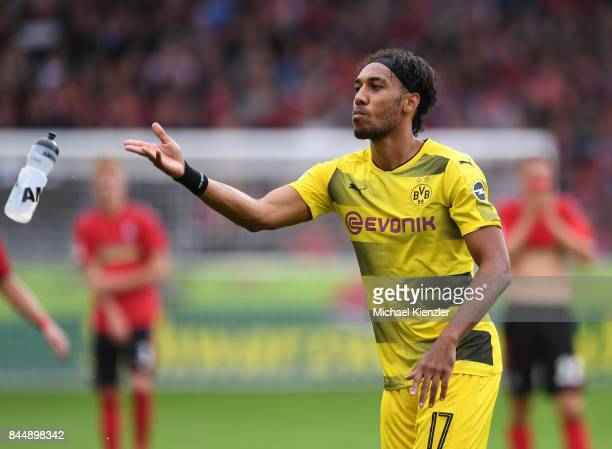 Pierre Emerick Aubameyang of Borussia Dortmund throws WaterBottle during the Bundesliga match between Sport Club Freiburg and Borussia Dortmund at...