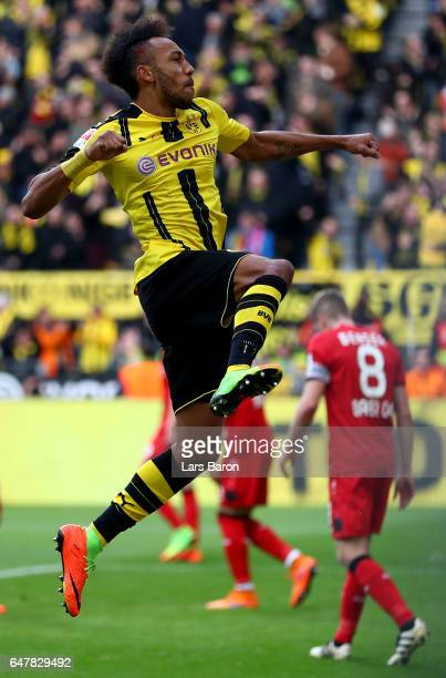 Pierre Emerick Aubameyang of Dortmund celebrates after scoring his teams third goal during the Bundesliga match between Borussia Dortmund and Bayer...