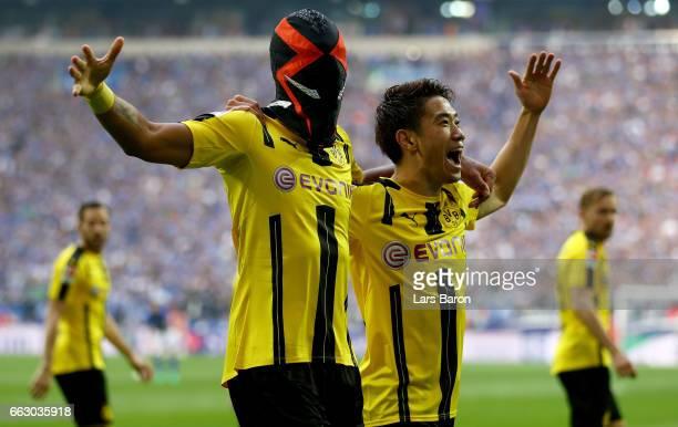 Pierre Emerick Aubameyang of Dortmund celebrates after scoring his teams first goal during the Bundesliga match between FC Schalke 04 and Borussia...