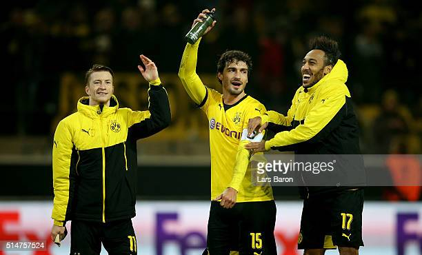 Pierre Emerick Aubameyang of Dortmund celebrates with team mates Marco Reus and Mats Hummels after winning the UEFA Europa League Round of 16 first...