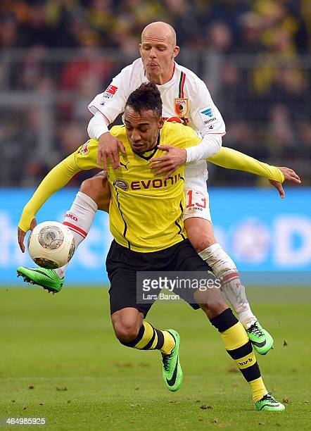 Pierre Emerick Aubameyang of Dortmund is challenged by Tobias Werner of Augsburg during the Bundesliga match between Borussia Dortmund and FC...