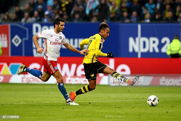 Pierre Emerick Aubameyang of Dortmund is scoring the 3rd goal during the Bundesliga match between Hamburger SV and Borussia Dortmund at...