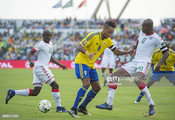 Pierre Emerick Aubameyang of Gabon and Charles Kabore of Burkina Faso during the Group A match between Gabon and Burkina Faso at Stade de L'Amitie on...