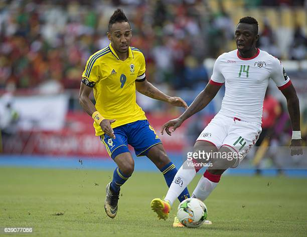 Pierre Emerick Aubameyang of Gabon and Issoufou Dayo of Burkina Faso during the Group A match between Gabon and Burkina Faso at Stade de L'Amitie on...