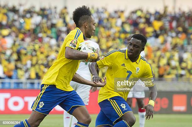 Pierre Emerick Aubameyang of Gabon celebrates his goal with Evouna Maloick during the Group A match between Gabon and Burkina Faso at Stade de...