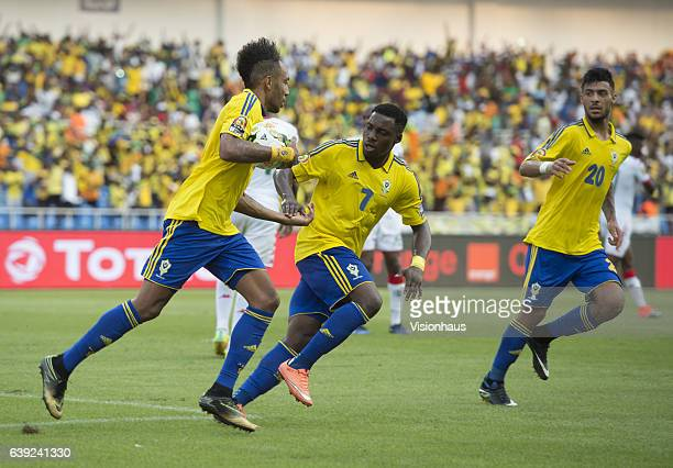 Pierre Emerick Aubameyang of Gabon is congratulated by Evouna Malick after he scores from the penalty spot during the Group A match between Gabon and...