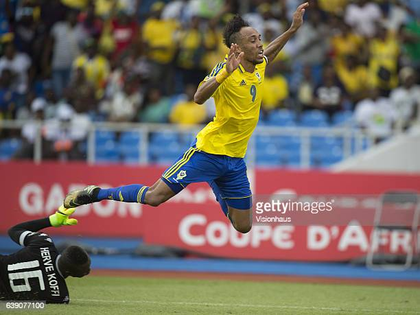 Pierre Emerick Aubameyang of Gabon is fouled by Kouakou Koffi of Burkina Faso and gives away a penalty during the Group A match between Gabon and...