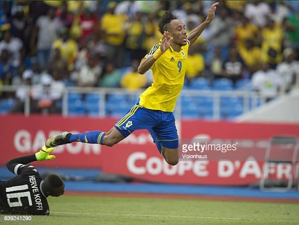 Pierre Emerick Aubameyang of Gabon is fouled by Kouakou Koffi of Burkina Faso during the Group A match between Gabon and Burkina Faso at Stade de...