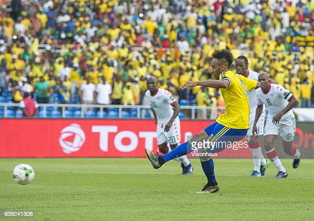 Pierre Emerick Aubameyang of Gabon scores from the penalty spot during the Group A match between Gabon and Burkina Faso at Stade de L'Amitie on...