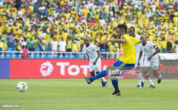 Pierre Emerick Aubameyang scores from the penalty spot for Gabon during the Group A match between Gabon and Burkina Faso at Stade de L'Amitie on...