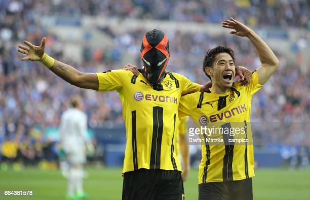 Pierre Emerick Aubameyang Shinji Kagawa celebrates as he scores the goal with a mask during the Bundesliga match between FC Schalke 04 and Borussia...