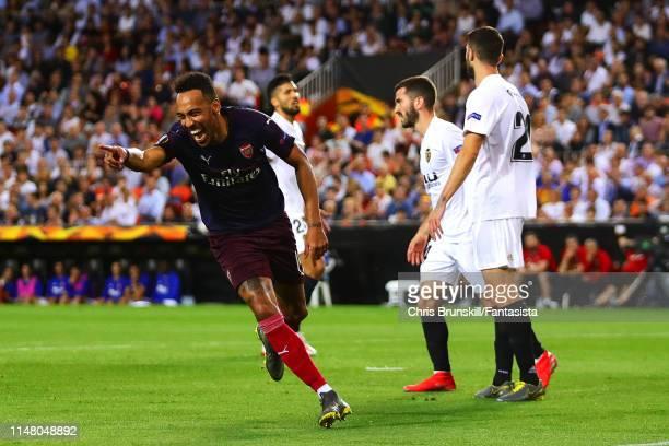 Pierre EmerickAubameyang of Arsenal celebrates scoring the equaliser during the UEFA Europa League Semi Final Second Leg match between Valencia and...